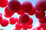 Large red balloons in the air.