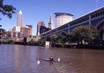Man rowing on the Cuyahoga River in Cleveland.