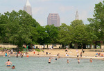 People on a public beach swimming in Lake Erie, Cleveland, Ohio.