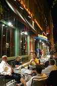 A group of men eating out at night in Cleveland, Ohio.