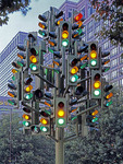 Traffic lights form a tree sculpture in London.