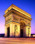 Arc de Triomphe at night in Paris.