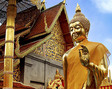 Gold Buddha statue in front of a temple in Bangkok.
