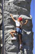 Young girl on a climbing wall.