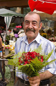 Fun man with a great smile buying flowers at a market in Lviv, Ukraine.