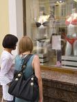 Two young women modern underwear shopping in colorful main street in Irkutsk, Russia.