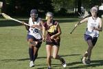 High school girls playing lacrosse.