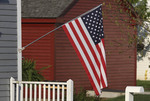 American flag on a side of the house.