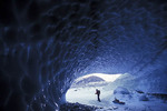 Ice cave explorer in Chugach National Forest.