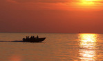 Power boat on Lake Erie at sunset.