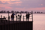 Couples at sunset looking at Lake Erie