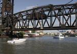 Boats o the Cuyahoga River waiting for lift bridge