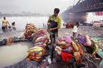 Dhobi Wallahs washing garments near the Yamuna RIver in Delhi INdi