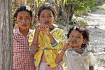 Three Cambodian girls begging.