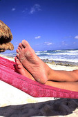 Colorful abstract of feet on hammock in Cozumel Mexico