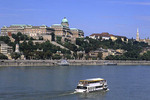 River Cruise ship on Danube River with Buda Castle in the background, Budapest, Hungary.