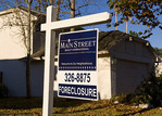 Economy woes of homes for sale in mortgage financial hard times, foreclosure recession.