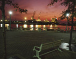 Cleveland inner harbor with ship unloading at sunset.