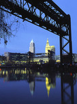 Cleveland skyline from the Cuyahoga River framed by RxR bridge.