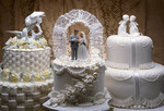 Three beautiful wedding cakes.