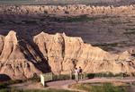 Tourists walking in Badlands National Park
