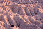 Couple views the Badlands National Park landscape