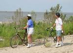 A couple on bikes by Lake Erie, Ohio.