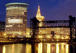 Cleveland skyline at night from the Cuyahoga River with Federal Court House building in foreground