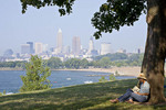 A woman reading a book at Edgewater Park in Cleveland, Ohio.