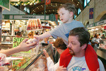 Father and son shopping at the Westside Market in Cleveland, Ohio.