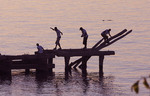 Kids play on old pier  at Edgewater State Park on Lake Erie  in Cleveland Ohio