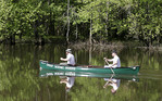 Two men canoeing the Upper Cuyahoga River in Geuaga County Ohio
