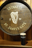 A Guinness barrel end and a glass of Guiness beer at a pub in the Temple Bar  district of Dublin Ireland