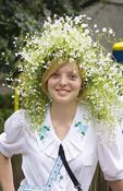 Woman in traditional costume of Ukraine with flowers in her hair, Kiev, Ukraine.