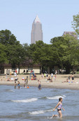 People swimming in Lake Erie at Edgewater State park in Cleveland