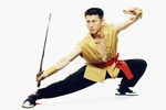 Mid adult man practicing martial arts with a sword.
