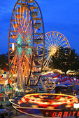 Raleigh, North Carolina State Fair, Ferris Wheels, carnival rides at dusk,
