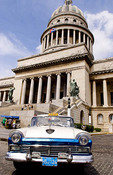 Classic American 50s Ford automobile in front of Capitol building in Havana Cuba
