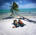 Couple sunning on a perfect tropical beach