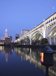Cleveland skyline at dusk with Cuyahoga River in foreground