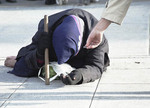Beggar at Notre Dame in  Paris France