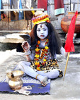 Young Indian boy dressed as an indian diety in  Pushkar, India young devotee incarnation of  the  godliness of lord shiva