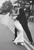 Newlyweds kissing.