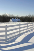 Winter barn with white fence and fresh snow