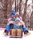 Mother and daughters on a toboggan ride