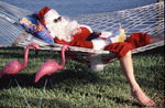 Santa Claus enjoying a break in a hammock