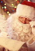 Santa Claus checking the who's been good who's been bad list.
