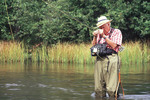 Older fly fisherman on the Au Sable River in Grayling, Michigan