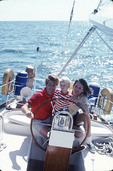 Couple with young child on sail boat