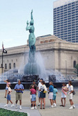 Group of tourist in downtown Cleveland at Mall C War Memorial statue